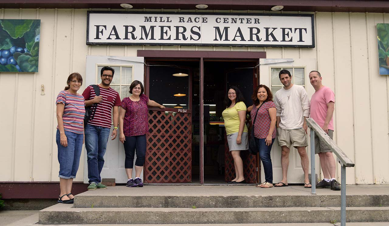 Pictured from left to right: Rose Gillin, Juan Carlos Diaz Quezada, Jo Ellen Davis, Sophia Metzger, Araceli Pacheco, Phil Metzler, and Joe Bradford in front of the Goshen Farmers Market.